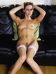 Petite girl in stockings spreading in the living room