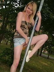 Blonde teen Vlada gives you lots of up-skirt views!