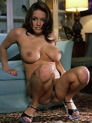 Big titted brunetter doing herself