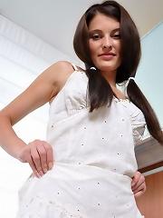 Cute teen pulls down her panties